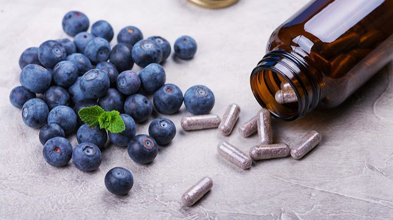 Natural Health Products beside fruit